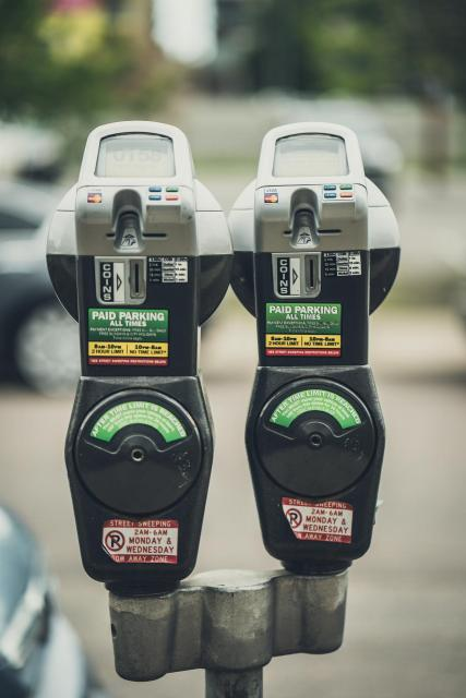 two parking meters on stand